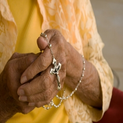 grandma_holding_rosary_shutterstock_40017103-255x255.jpg
