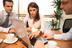 stock-photo-2811391-three-business-persons-working-with-laptop-in-sunny-office.jpg