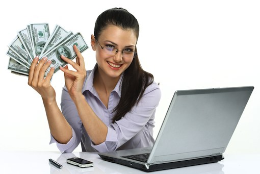 woman-with-money-at-computer-shutterstock-510px.jpg